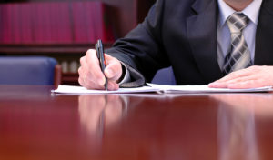bigstock-Businessman-Is-Signing-A-Contr-1411278